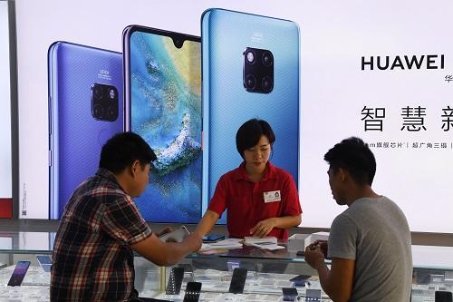 日媒关注中国民间兴起力挺华为潮: 华为手机用户景点免门票